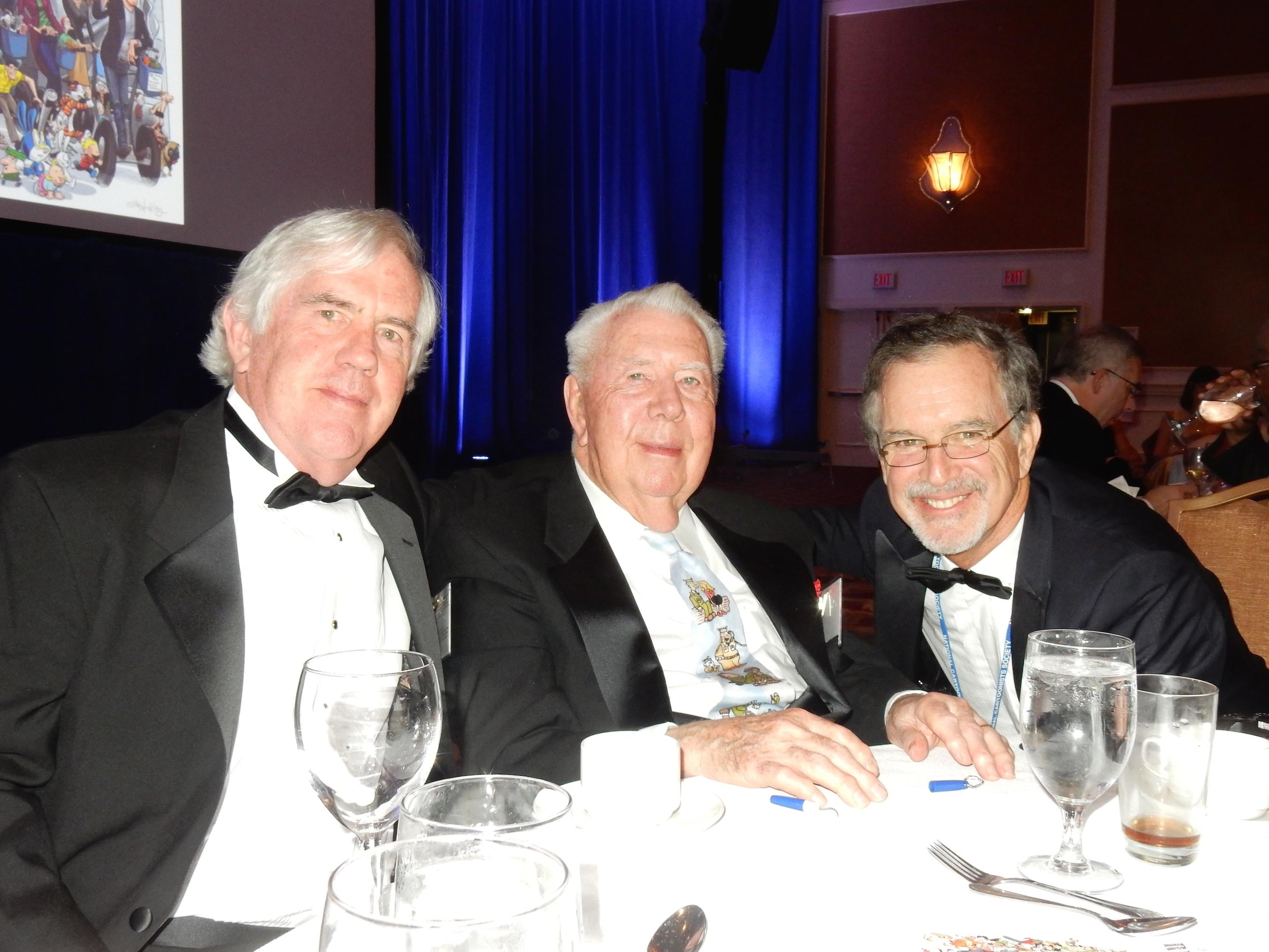 Left to right:  Brian Walker, Mort Walker, Garry Trudeau