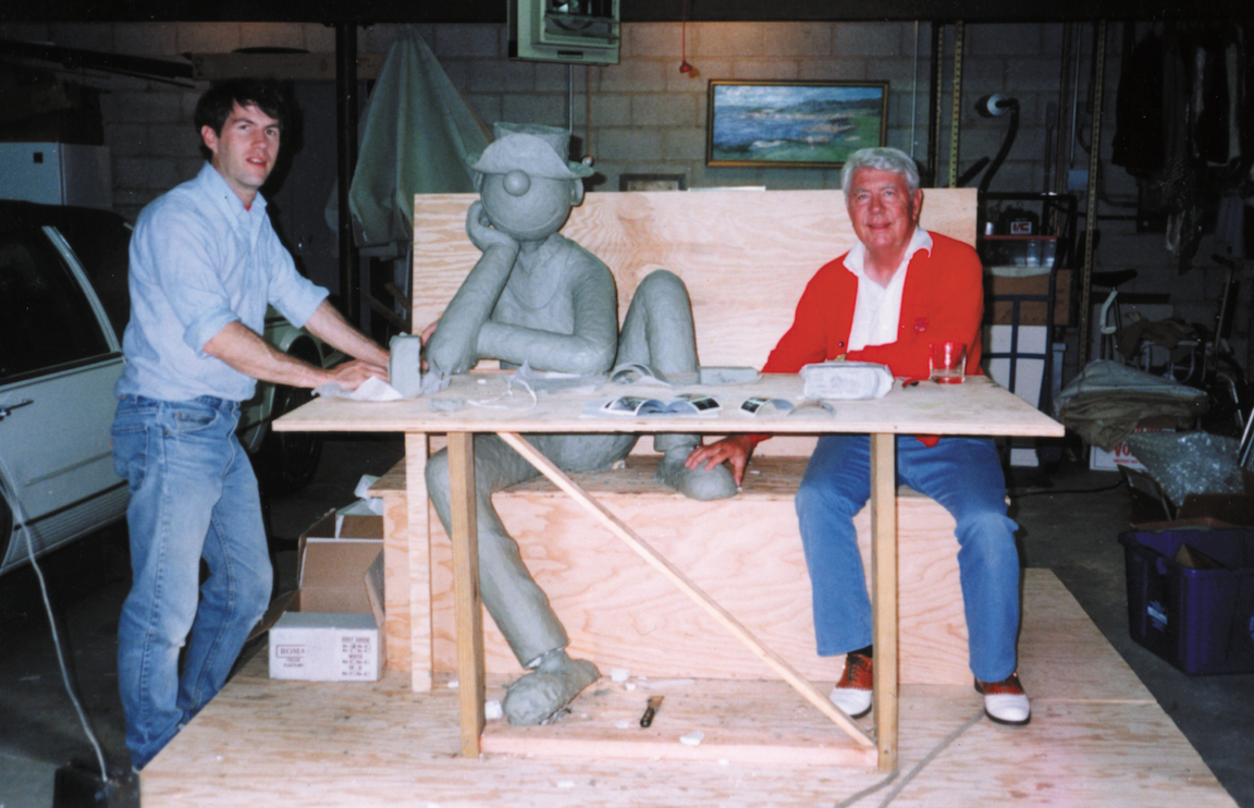 Neal and Mort Walker with the clay sculpture of Beetle Bailey.