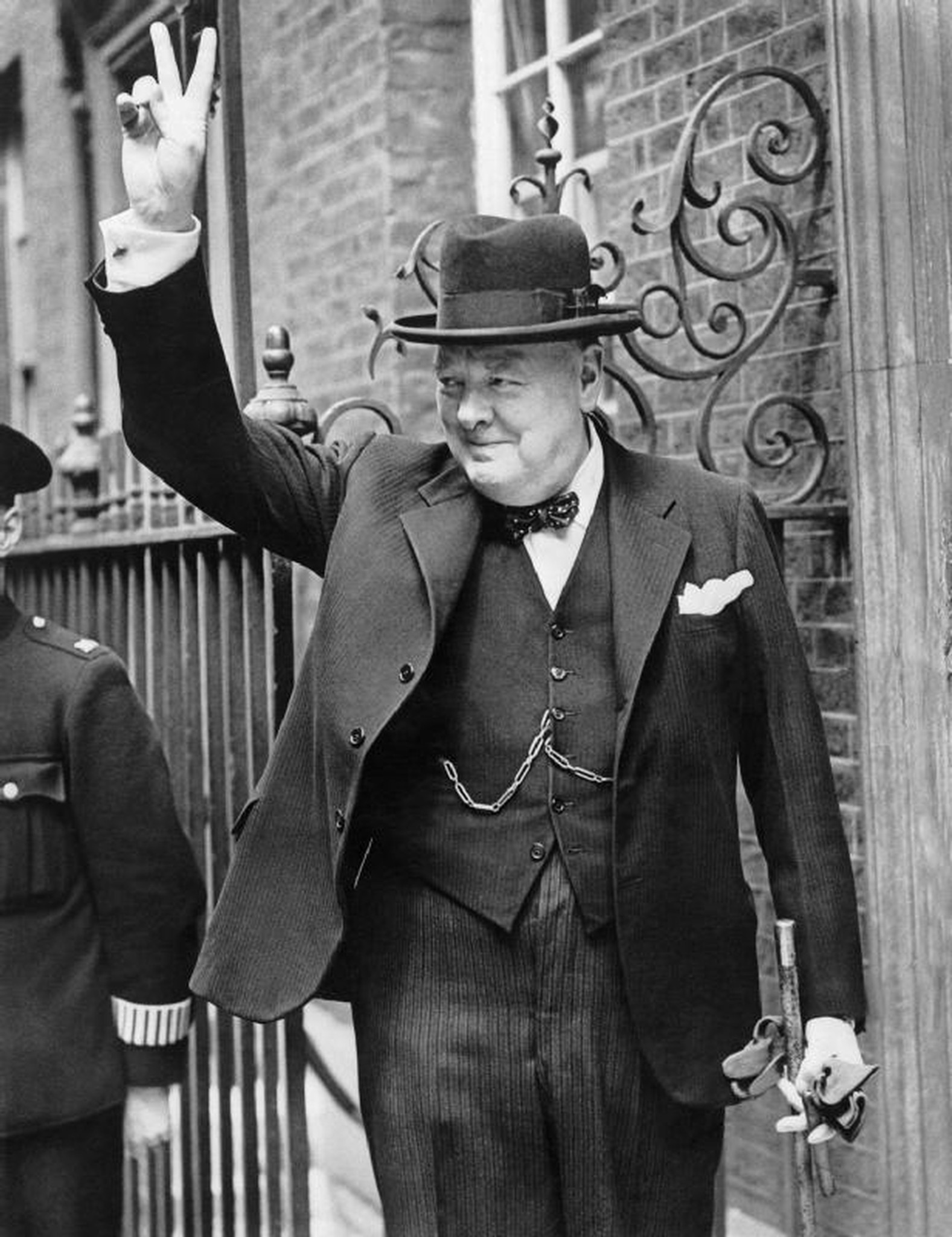 """Winston Churchill flashes the """"v for victory"""" sign in 1943."""