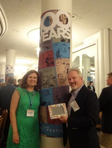 Karen and I with the special Snuffy Smith comic strip frame in front of one of the specially decorated 1000th Anniversary columns.
