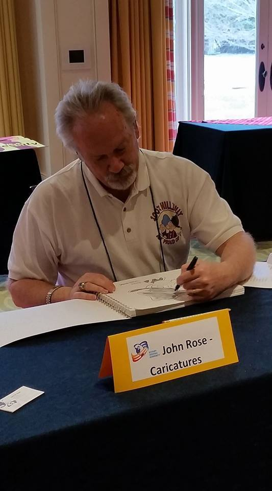 John Rose drawing at Rotary Conference fundraiser