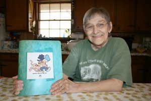 Sue Davis has collected hundreds of Snuffy Smith comic strips in a binder over the past 50-plus years! Photo by Severo Avila/Rome News-Tribune