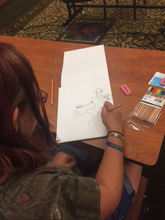 A very talented young girl drawing Ol' Bullet in one of John Rose's Children's Cartooning Workshops